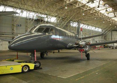 Gray Bandit in aircraft hangar