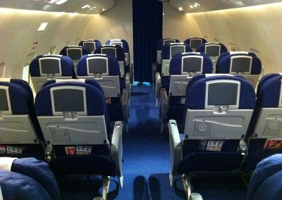 commercial airliner rear seats with televsion screens