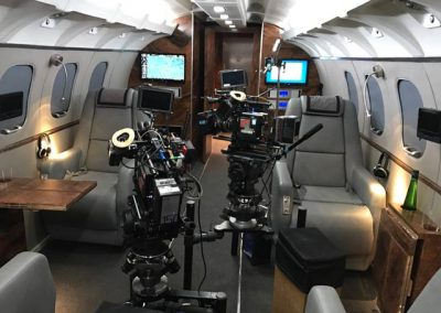 New private jet interior with filming equiment